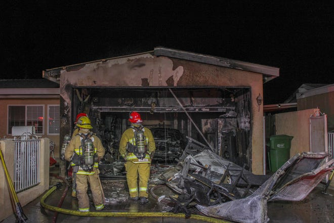Ventura County Firefighters extinguish a garage fire in Moorpark Thursday night.