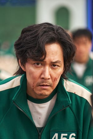 "Gi-hun (Lee Jung-jae) in ""Squid Game."""