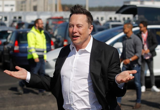 Tesla CEO Elon Musk gestures as he visits a construction site near Berlin.