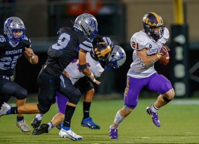 Liberty Hill Panthers running back Noah Long, right, breaks away for the run against the McCallum Knights during the third quarter of the District 14-5A Division II game Friday at House Park. Long ran for a career-high 202 yards and Liberty Hill seized sole possession of first place in the district race with a 45-16 win.
