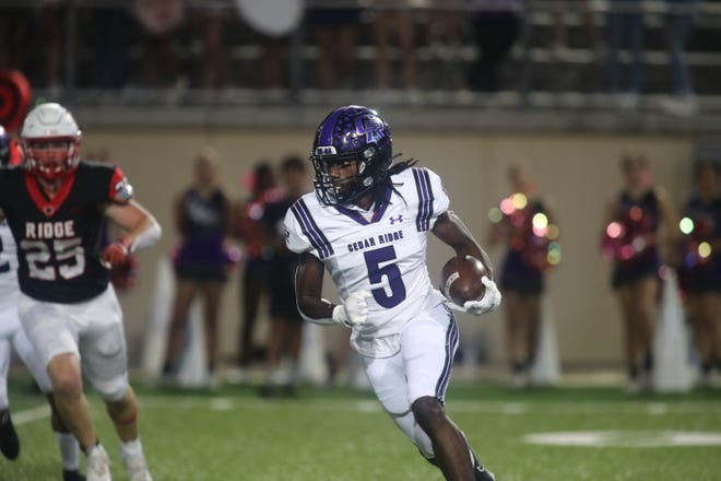 Cedar Ridge standout Victor Taylor Jr. looks for room to accelerate against Vista Ridge Oct. 8 in District 25-6A action at Gupton Stadium. Cedar Ridge held on to defeat Vista Ridge by a final score of 25-21.