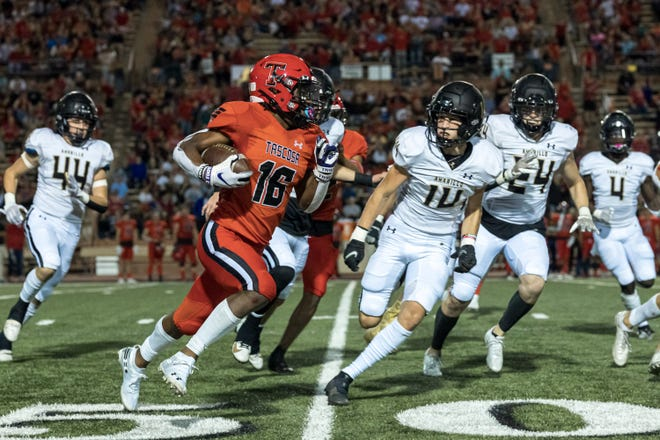 Tascosa Rebels running back Major Everhart (16) runs the ball at a game against the Amarillo High Sandies at Dick Bivins on Friday, October 8, 2021 in Amarillo, TX