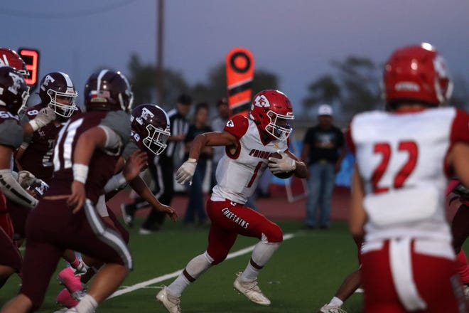 Friona running back Jacob Bautista (center) carries the ball down the field against the Tulia defense during District 3-3A Division II game Friday, Oct. 9, 2021 at Younger Field in Tulia, Texas.