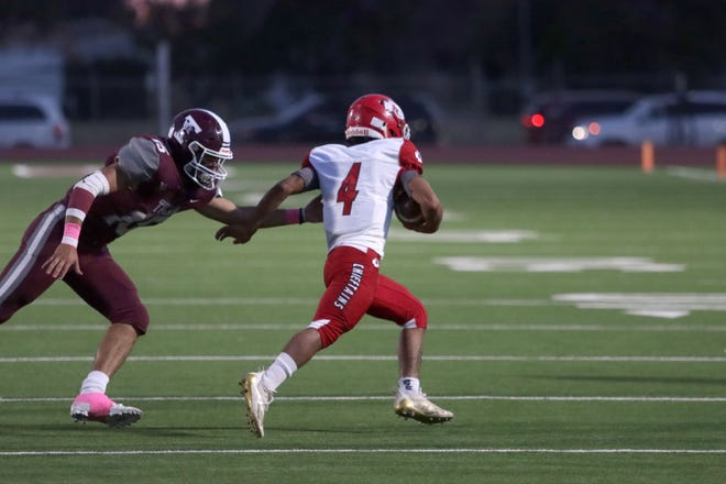 Friona running back Mario Bautista dodges a tackle during a District 3-3A Division II game on Friday Oct. 9, 2021 at Younger Field in Tulia, Texas.