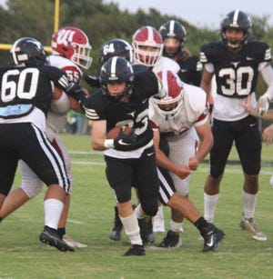 Lone Grove's Braxton Sparks rushed for three touchdowns Friday in a 51-6 win over Dickson.