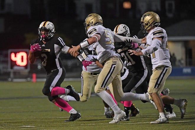 Patrick Cutchember #3 of the Quaker Valley Quakers carries the ball in the first half during the game against the Hopewell Vikings at Chuck Knox Stadium on October 8, 2021 in Leetsdale, Pennsylvania.
