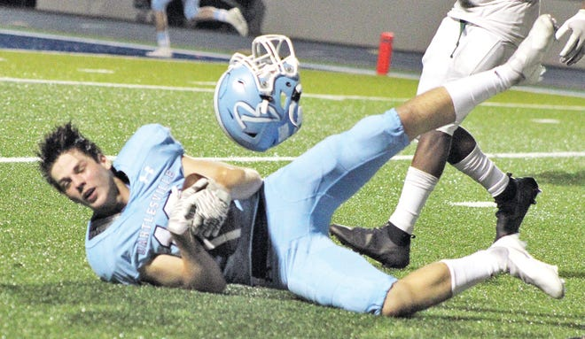 Eli Lino holds on to a catch for the Bartlesville High Bruins during one of their impressive offensive drives Friday night against Muskogee. (Mike Tupa/Examiner-Enterprise)