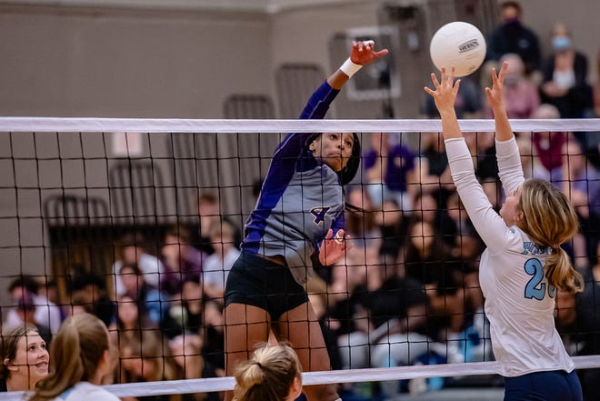 Hickman's Jerica Jackson (4) gets the kill over the fingers of Tolton's Bella Barnes (25) on Thursday.