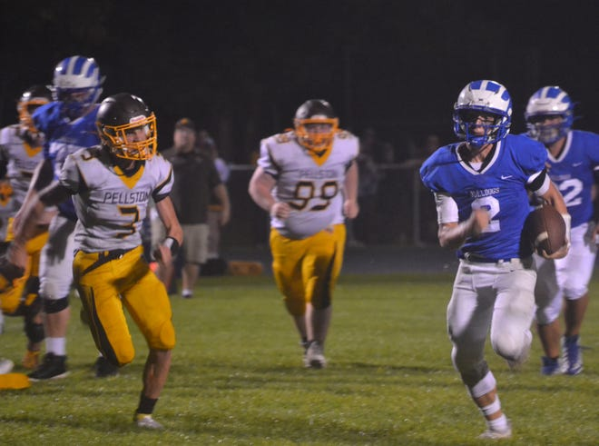 Inland Lakes senior quarterback Mason Blumke, right, heads for the end zone while Pellston sophomore defender Kenny Crawford chases during the second quarter of a Ski Valley football matchup in Indian River on Friday night.