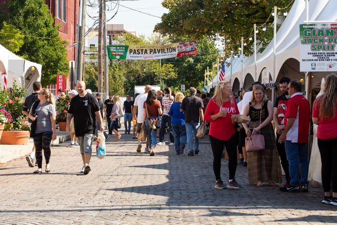 Patrons of the 2021 Columbus Italian Festival on Saturday outside of St. John the Baptist Catholic Church enjoyed the sunny fall day and the return of the festival after a one-year hiatus due to the COVID-19 pandemic. The festival continues Sunday from noon to 7 p.m. at the church, 720 Hamlet St.