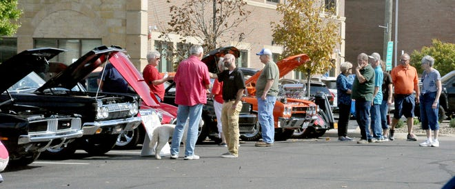 A large crowd checked out the cars in the car show at the Holmes County Antique Festival in Millersburg on Saturday. The fun continues Sunday, with the grand parade at 2 p.m.