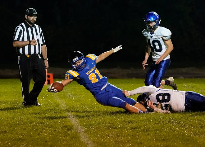 Madison's Isiah Casarez-Ruiz stretches the ball across the plain during Friday's game against Pittsford. [Telegram photo by Mike Dickie]