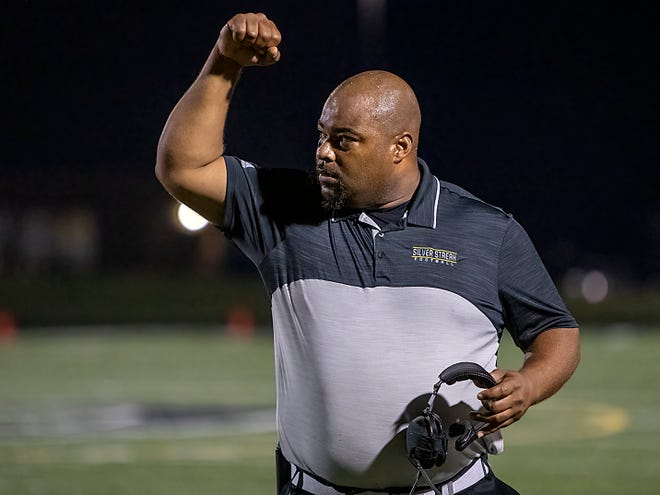 Galesburg High School football coach Derrek Blackwell calls in a play against Rock Island on Friday, Oct. 1 at Van Dyke Field. The Silver Streaks fell to the Rocks 33-30 in overtime that evening.