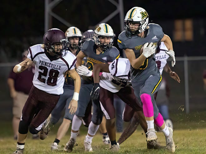 Abingdon-Avon High School senior Parker Darst breaks away from the pack during the Tornadoes' 18-7 win over Princeville on Friday, Oct. 8, 2021 at Don Viar Field.