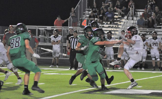 Tioga's Caiden Brennan leads the charge as the Bulldogs blocked a Trenton punt during District 5-2A (I) action.