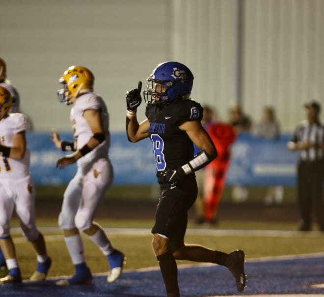 Gunter's Ethan Sloan celebrates after one of his touchdowns in a District 8-3A (II) win over Leonard.