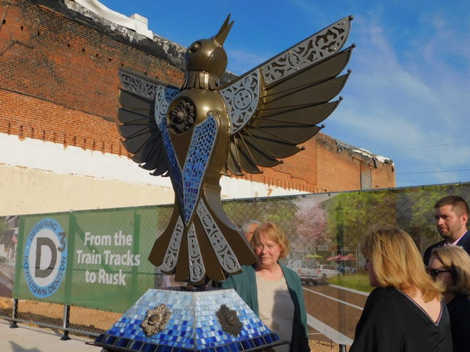 A new art installation in downtown Denison pays honor to the three downtown buildings that were destroyed in a fire in 2019.