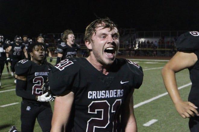 Buhler senior linebacker Tanner Tustian celebrates after the Crusaders beat the McPherson Bullpups 42-30 Friday, Oct. 8, 2021, at Buhler Crusaders Stadium.