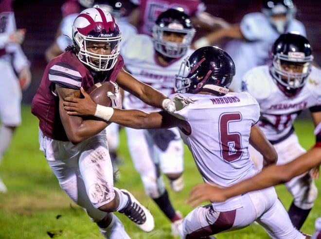 Peoria's Eddie Clark, left, tries to outmaneuver Matthew McMullen and the Champaign Central defense in the first half Friday, Oct. 8, 2021 at Peoria Stadium.