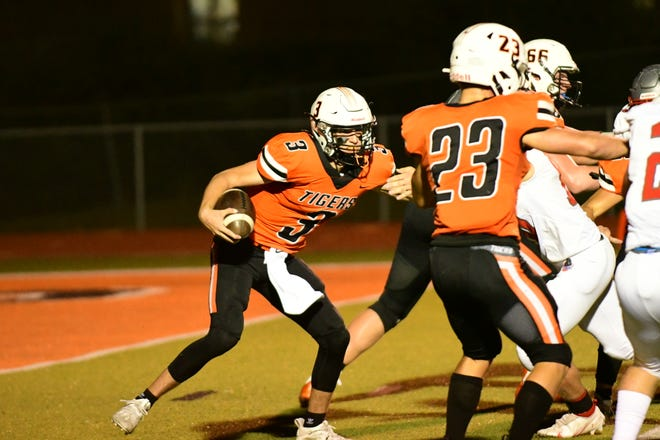 Kirksville quarterback Ike Danielson carries the ball on the scramble during Friday's 28-14 win over Mexico.