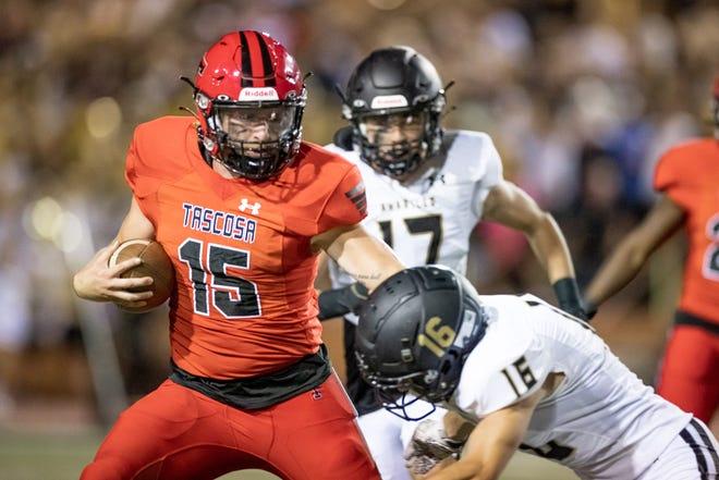 Tascosa quarterback BT Daniel (15) fends off Amarillo High defensive back Luke Laminack (16) during a District 2-5A Division I game Friday, Oct. 8, 2021 at Dick Bivins Stadium in Amarillo.