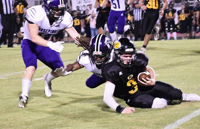 Rosepine Michael Woods (10) brings down Kinder quarterback Graham Fawcett on fourth down during the Eagles' 48-22 win over the homesteading Yellow Jackets on Friday.