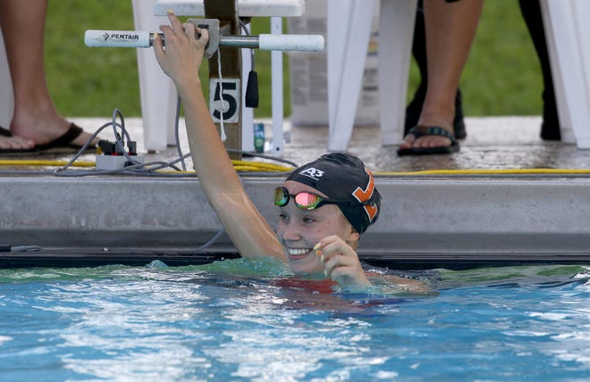 Lakeland senior Lutnya Bogdanova is all smiles after setting her second record on Saturday at the 2021 Polk County Swim/Dive Championships at Rowdy Gaines Pool. She just swam the 100-yard breaststroke and early set a record in the 100 butterfly.