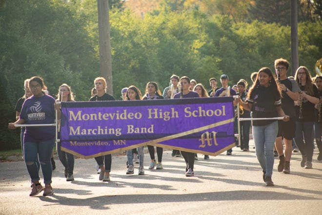 The Montevideo High School Marching band plays their way through the Homecoming Parade Friday evening.