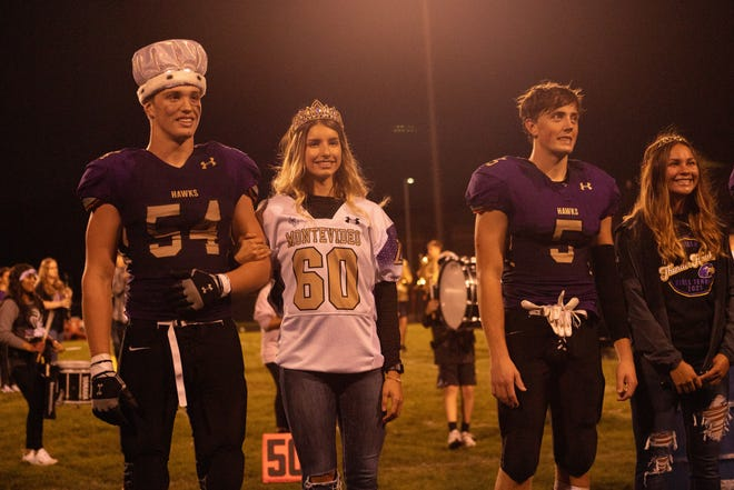 King Callim Schmitz, Queen Lana Rongstad, Prince Andrew VanBinsbergen and Princess Emily Brace at the halftime show during Friday's Football game.