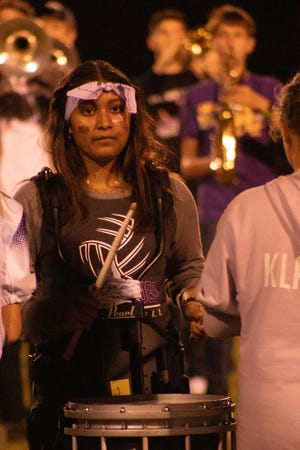 Erika Quintanilla plays the drums in the band's half-time performance.
