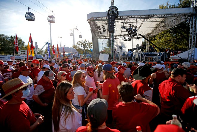 Fans crowd the area around the ESPN College GameDay set before the Red River Showdown college football game between the University of Oklahoma Sooners (OU) and the University of Texas (UT) Longhorns at the Cotton Bowl in Dallas, Saturday, Oct. 9, 2021.
