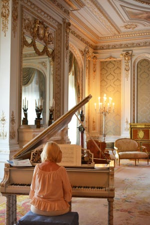 Anne Akerson plays one of the Flagler Museum's historic Steinway & Sons pianos in the drawing room.
