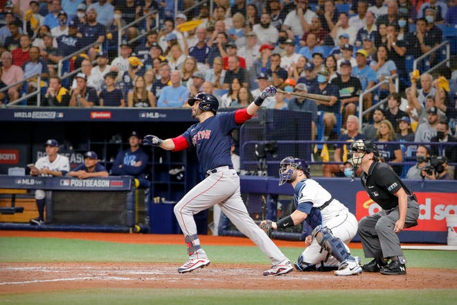 Oct 8, 2021; St. Petersburg, Florida, USA; Boston Red Sox designated hitter J.D. Martinez (28) hits a three run home run against the Tampa Bay Rays during the fifth inning in game two of the 2021 ALDS at Tropicana Field. Mandatory Credit: Mike Watters-USA TODAY Sports
