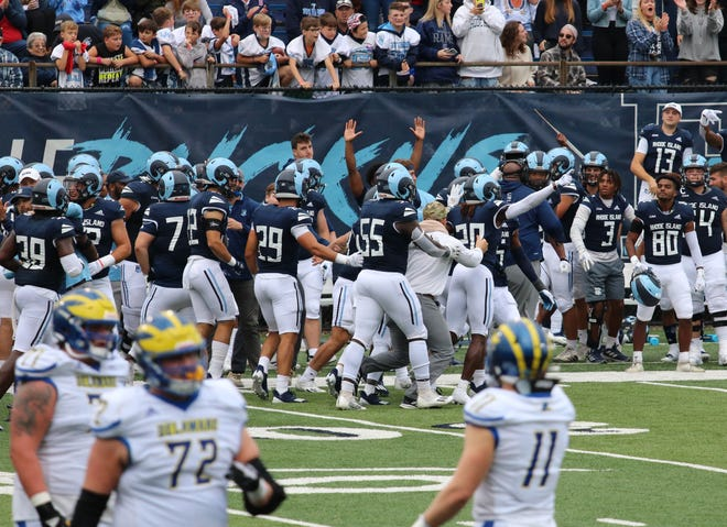 URI celebrates its win over Delaware at Meade Stadium on Saturday. The Rams beat the Blue Hens, 22-15, in front of a full house in Kingston.