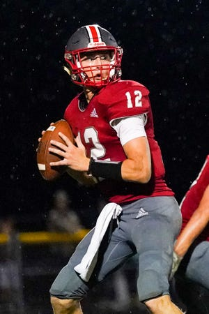 Crestwood quarterback Evan Daniels sets up to throw down field for an open reciever against Cardinal at Crestwood High School on October 8, 2021.