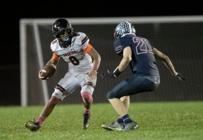 Harlem's Deandre Young, shown putting a move on Belvidere North's Zachary Rieches, rushed for 114 yards in a 27-14 victory at Belvidere North High School on Friday, Oct. 8, 2021.