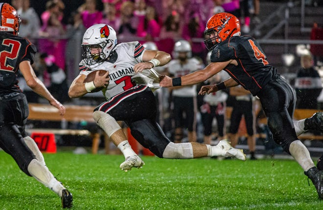 Winnebago's Lucas Cowman hangs on to Stillman Valley running back Jory Spain to hold him to a short gain in the first quarter of their game in Winnebago on Friday, Oct. 8, 2021.