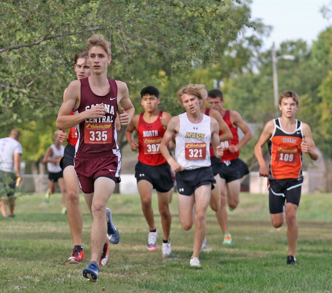 Salina Central senior Will Griffith (335) leads a pack of runners during Saturday's Salina Invitational cross country meet at Bill Burke Park. Griffith finished fourth with a school-record time of 16 minutes, 36.14 seconds.