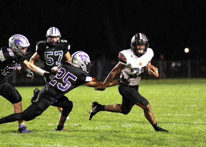 Jacob Thompson breaks a tackle from several Three Rivers defenders Friday night before picking up a first down on Friday.