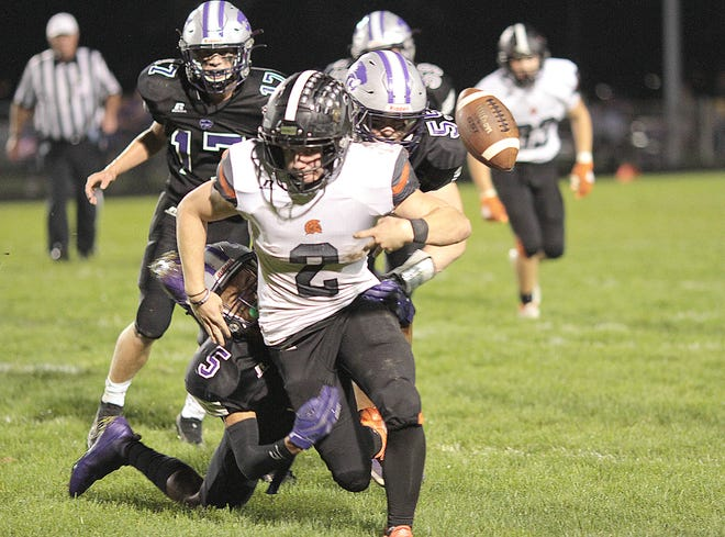 Three Rivers' Lloyd Ruesink (55) and Angelo Hausmanis combine to force a fumble by Sturgis' Brenden Myers on Friday night.