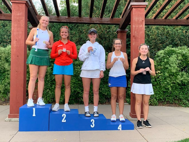 Aberdeen Central's Emily Ringgenberg smiles on the podium after finishing fourth overall in Flight 1 singles at the Class AA state championship. Courtesy of South Dakota Public Broadcasting.