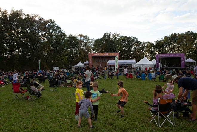 it was a relaxed setting at the Hocking Hills Music Festival, with children playing with the bands played.