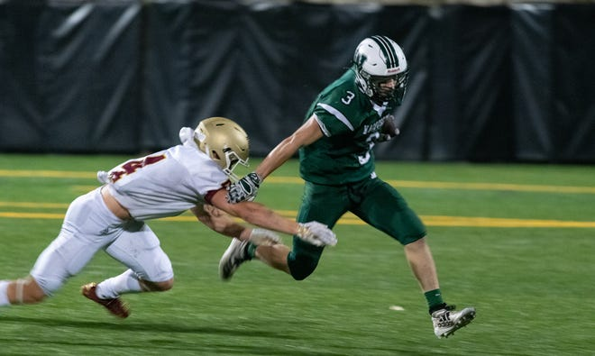 Wachusett's Jake Larson tries to outrun Doherty's Colin Wanat.