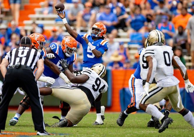 Florida quarterback Emory Jones (5) throws a pass to running back Dameon Pierce for a touchdown during the third quarter Saturday against Vanderbilt at Ben Hill Griffin Stadium. Jones had a career-high four touchdowns passes.