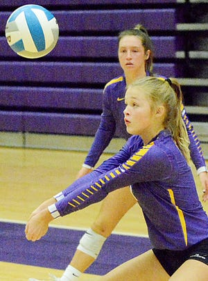 Watertown's Addi Johnston makes a dig in front of teammate Kayla Vohlken during a match against Douglas on Friday in the East-West Volleyball Classic in the Civic Arena.