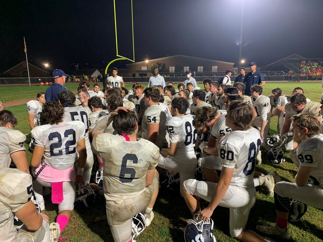 Middletown South football coach Steve Antonucci (left) addresses his players after the win over Southern