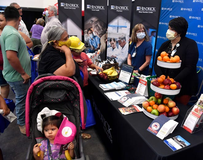 Families and others visit Business Mercado on Saturday at the Abilene Convention Center.