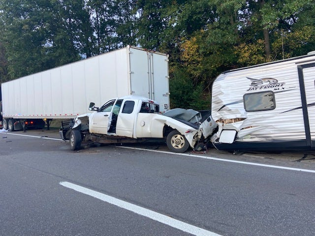 The driver of a stopped semi was killed when a pickup pulling a camper struck the back of the truck trailer Friday.  (Provided)