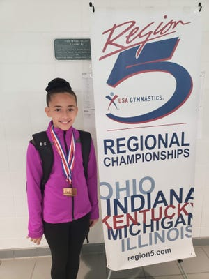 Photo courtesy of Amanda Lankerd, this photograph shows Ayla Lankerd at regional gymnastics championships.