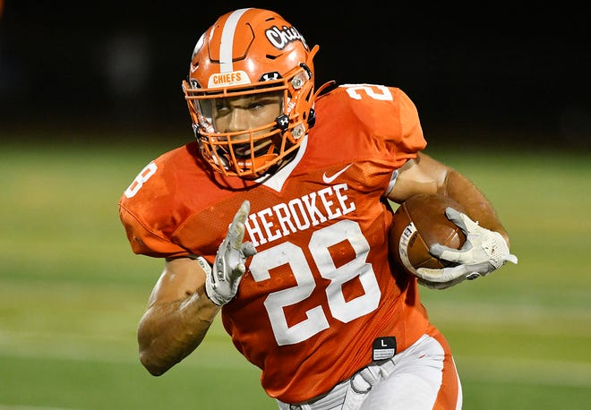 Cherokee's Brandon Boria (28) runs for a touchdown during Fridays football game against visiting Shawnee. The Chiefs defeated Shawnee 56-21. Oct. 8, 2021.